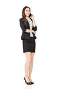 Asian business woman talking on cell phone Royalty Free Stock Photo