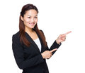 Asian business woman with two hand point aside isolated on white Royalty Free Stock Photo