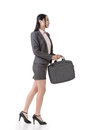 Asian business woman walk side view full length portrait isolated on white background Royalty Free Stock Images