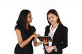 Asian business women two happy young presenting on a white background Royalty Free Stock Photo