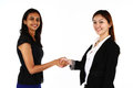 Asian business women two happy young shaking hands on a white background Stock Images