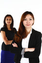 Asian business women two happy young standing together on a white background Royalty Free Stock Images
