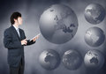 Asian Businessman choosing Europe continent, business concept of Royalty Free Stock Photo