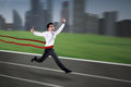 Asian businessman crossing the finish line Royalty Free Stock Photo