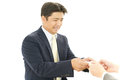 Asian businessman exchanging business cards portrait of an Royalty Free Stock Images