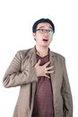Asian businessman heartache pressing on chest heart attack is with painful expression isolated white background Royalty Free Stock Image