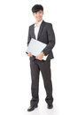 Asian businessman hold a laptop full length portrait on white background Stock Images