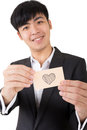 Asian businessman holding a card written on heart shape closeup portrait Stock Image