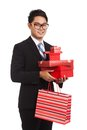 Asian businessman with many gift boxes and shopping bag Royalty Free Stock Photo
