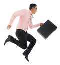 Asian businessman running or jumping full body young up with a briefcase isolated on white background Royalty Free Stock Photography