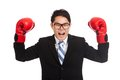 Asian businessman satisfy with red boxing glove isolated on white background Royalty Free Stock Photography