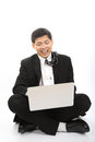 Asian businessman sit and play laptop in studio with white background Stock Images