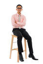 Asian businessman sitting on a wooden chair full body transparent block isolated white background male model Royalty Free Stock Photography