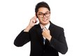 Asian businessman smile  talk and point to mobile phone Royalty Free Stock Photo