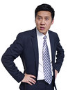 Asian businessman studio portrait of an angry arms akimbo Stock Image