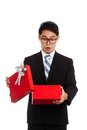 Asian businessman surprise open red gift box Royalty Free Stock Photo