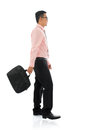 Asian businessman walking with briefcase full body side view young isolated on white background Royalty Free Stock Photography