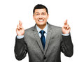 Asian businessman wishing hoping happy young fingers crossed smiling Royalty Free Stock Photography