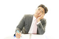 Asian businessman working at the desk being tired and stressed Royalty Free Stock Photography