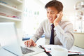 Asian Businessman Working From Home Using Mobile Phone Royalty Free Stock Photo