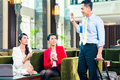 Asian businesspeople having meeting in hotel Stock Photos