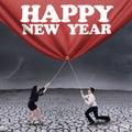 Asian businessteam drag new year banner Stockfotografie