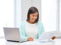 Asian businesswoman with laptop and documents business education technology concept or student in office Stock Images