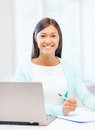 Asian businesswoman with laptop and documents business education technology concept or student in office Stock Photos