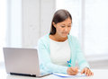 Asian businesswoman with laptop and documents business education technology concept or student in office Stock Photo
