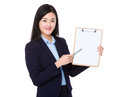 Asian businesswoman with pen point to blank clipboard isolated on white background Stock Image