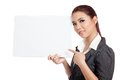 Asian businesswoman point to a blank sign and smil Royalty Free Stock Photo