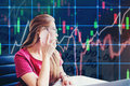 Asian businesswoman sitting on working space and looking the Stock market exchange information and Trading graph Royalty Free Stock Photo