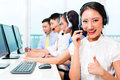 Asian call center agent team on phone Royalty Free Stock Photo