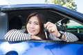 Asian car driver woman smiling showing new car keys Royalty Free Stock Photo