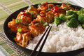 Asian Chicken tso with rice and broccoli close-up. Horizontal Royalty Free Stock Photo