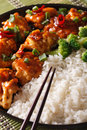 Asian Chicken tso with rice and broccoli close-up. vertical Royalty Free Stock Photo