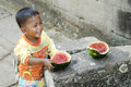Asian child eating fruit in cambodia Stock Images