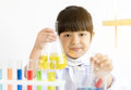 Asian child playing scientist with colorful lab tubes Royalty Free Stock Photo
