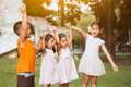 Asian children holding hand and raise their hand
