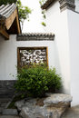 Asian chinese antique buildings white walls tiles and wooden window beijing garden expo gray carved very simple very beautiful Stock Image