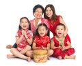Asian chinese family group of happy multi generations wishing you a happy new year with traditional cheongsam sitting Stock Images