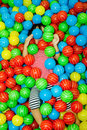 Asian chinese girl in ball pool hide colorful at indoor playground Royalty Free Stock Photography