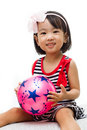 Asian chinese girl holding ball in white background Stock Photo