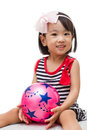 Asian chinese girl holding ball in white background Royalty Free Stock Image