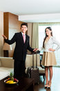 Asian chinese hotel manager presenting suite or director or supervisor arriving vip guests the room or Stock Photos