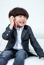 Asian Chinese little boy sitting on the couch with smartphone Royalty Free Stock Photo