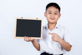 Asian Chinese Little Boy Wearing Student Uniform Pointing Chalkb Royalty Free Stock Photo