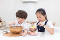 Asian Chinese little brother and sister preparing to bake cookie Royalty Free Stock Photo