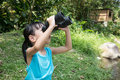 Asian Chinese little girl exploring around with binoculars
