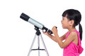 Asian Chinese little girl holding a telescope